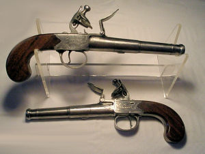 Click to enlarge A pair of cannon barrelled 28 bore flintlock boxlock overcoat pistols by Griffin.