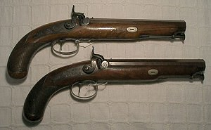 Click to enlarge image of A pair of fine 17 bore back action lock-off pistols with swivel ramrods by NOCK