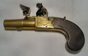Click to enlarge a 34 bore flintlock boxlock pocket pistol with brass frame and barrel and with concealed trigger