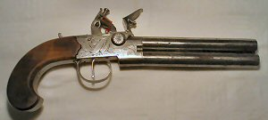 Click to enlarge a very rare and massive over-under 28 bore flintlock boxlock tap action pistol by NOCK.
